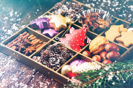 Wooden box filled with christmas decorations