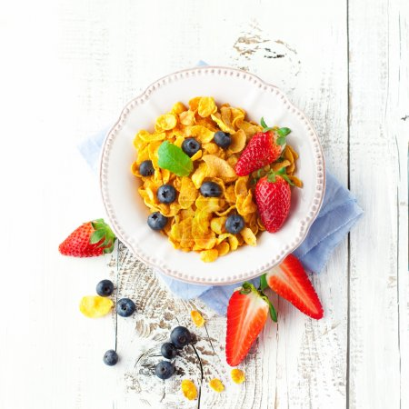 Photo for Healthy breakfast with cornflakes and fresh berries on white wooden background, top view - Royalty Free Image