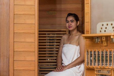 Infrared sauna cabin with thai woman