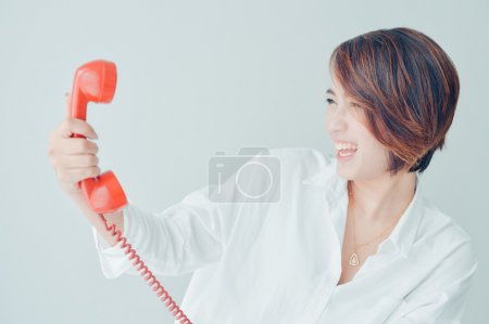 Photo for Asian woman with retro telephone in vintage color - Royalty Free Image