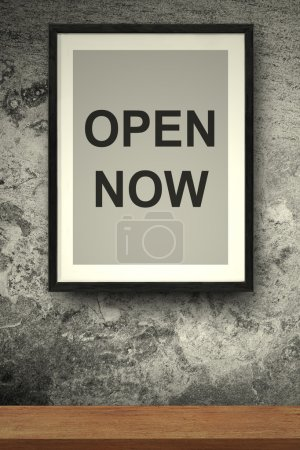 Photo for OPEN NOW quote on the photo frame concreate background - Royalty Free Image