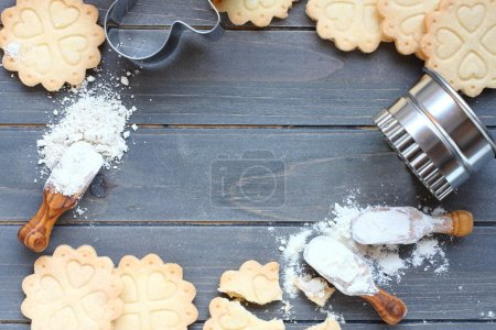 Photo for Background of baking gluten free shortbread cookies with utensils and ingredients,  viewed from above - Royalty Free Image