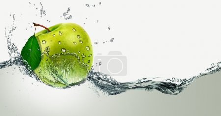 Green Apple amid splashing water.