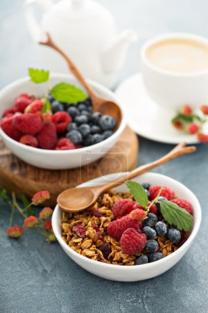 Granola and fresh berries with coffee for healthy ...