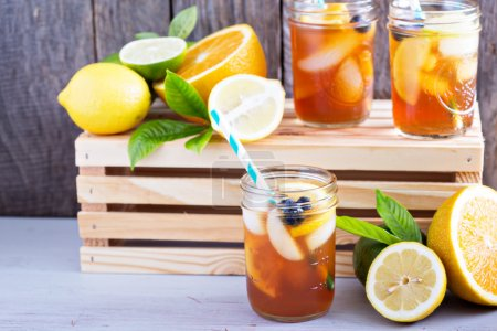 Photo for Homemade iced tea in mason jars with straws - Royalty Free Image
