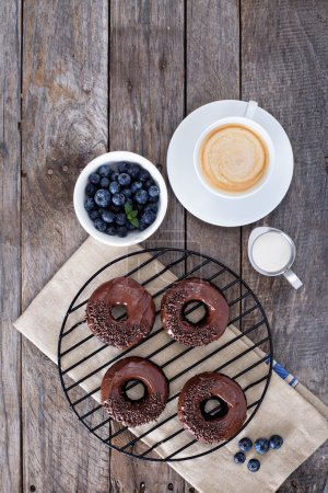 Photo for Chocolate gluten free donuts with coffee and blueberries - Royalty Free Image
