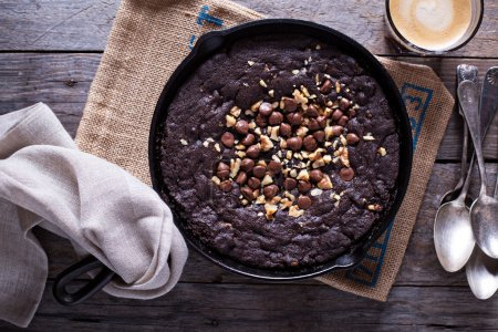 Photo for Chocolate giant skillet cookie with walnuts and milk chocolate chips - Royalty Free Image