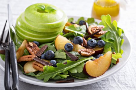 Fresh healthy salad with greens and apple