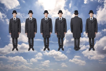 Photo for Businessmen floating over blue sky with clouds, magritte style - Royalty Free Image