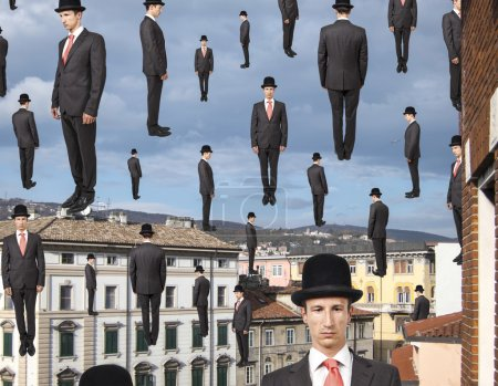 Photo for Businessmen floating in the sky over european city, magritte style - Royalty Free Image