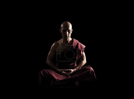 buddhist monk in meditation pose