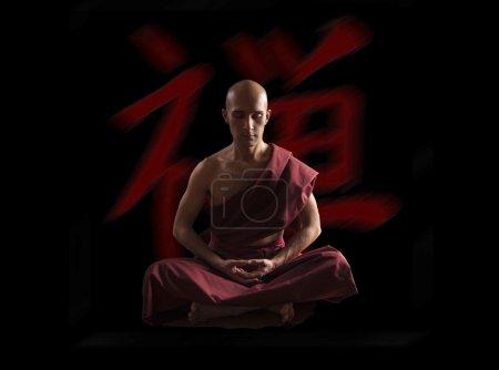 buddhist monk in meditation pose