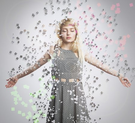 Photo for Artistic portrait of young beautiful blonde woman, explosion dispersion effect - Royalty Free Image