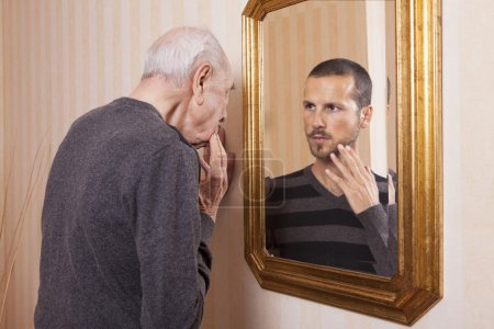 old man looking at young himself