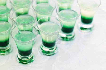 Photo for Raw of green mint shot drinks for party - Royalty Free Image