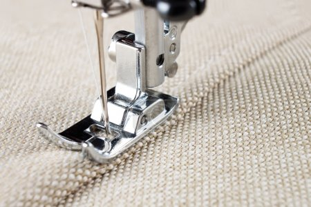 Photo for Sewing machine makes a seam on fabric. sewing process - Royalty Free Image