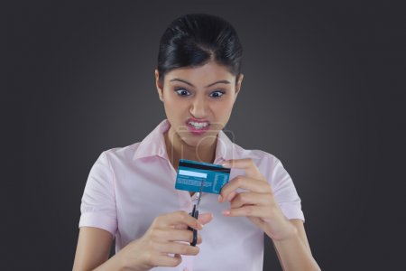 Businesswoman holding credit cards