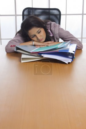 Businesswoman tired with work pressure