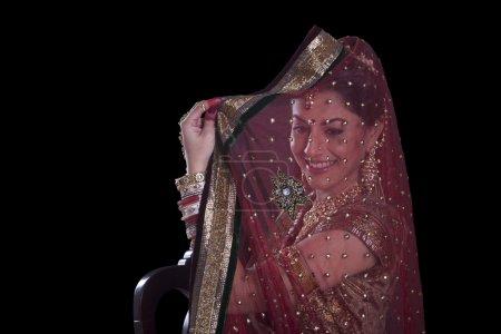 Beautiful bride hiding her face