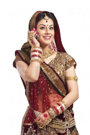 bride talking on a mobile phone