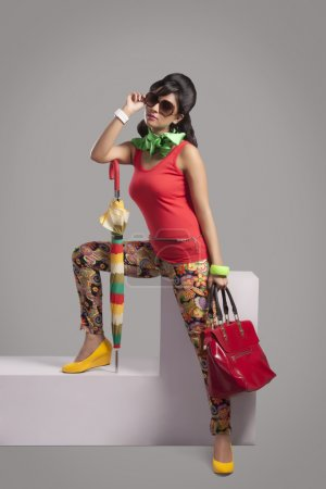 woman with hand bag  posing