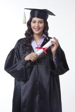 woman holding diploma
