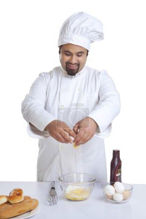 Chef cracking egg
