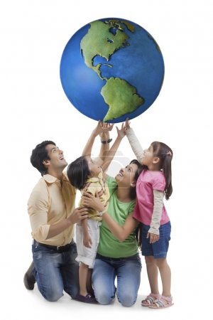 Family touching world globe