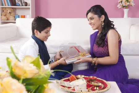 Sister giving gift to her brother