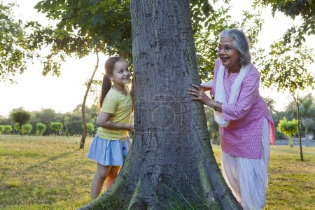 Grandmother and granddaughter playing