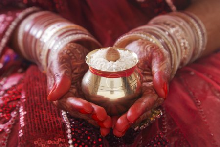 hands performing marriage rituals
