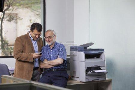 executives looking at sms