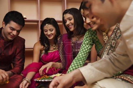 happy Friends making a rangoli