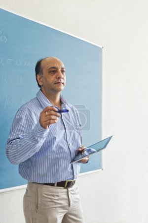 Teacher holding a digital tablet