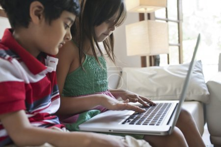 Brother and sister with laptop