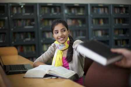 Teenager sitting in library