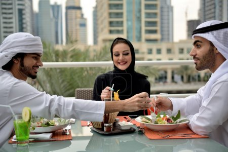 Emirati arab family dining at a restaurant