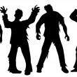 Black silhouettes of zombies isolated on white...