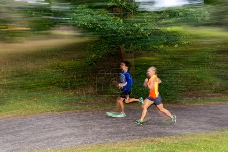 Runners in motion blur in forest at the event 5K EASD Run Walk t