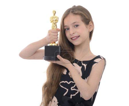 Photo pour Vainqueur Girl Holding Trophy isolée on White Background - image libre de droit