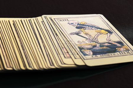 Deck of Tarot Cards with Death Card on Top