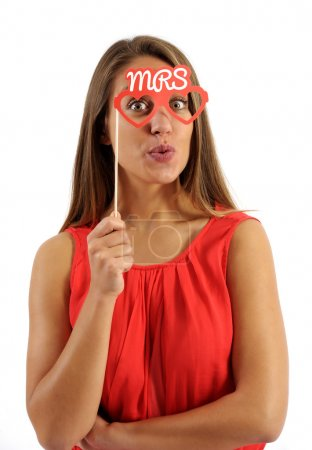 Young Woman Holding Photo Booth Prop