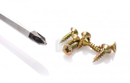 Photo for Screws and screwdriver isolated on white background - Royalty Free Image
