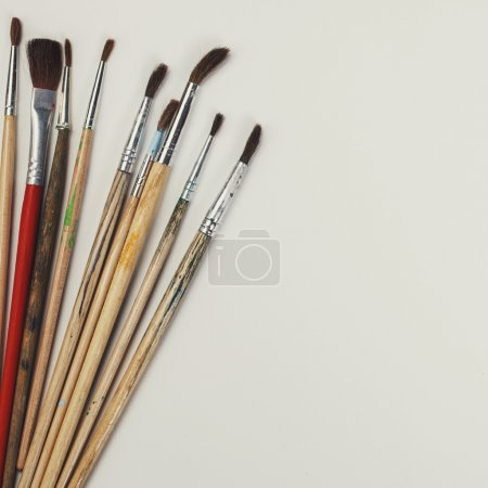 Brushes for painting  and blank white paper sheet