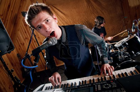 Boy sings into microphone