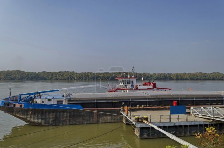 Photo for River cargo boat at pontoon in Ruse Danube port, Bulgaria - Royalty Free Image