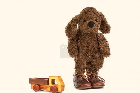 Soft toy cocker spaniel and a wooden machine