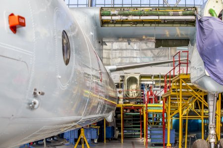 Aircraft stands on repair in aviation hangar