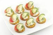 Crackers with Cheese Tomato Cucumber and Dill