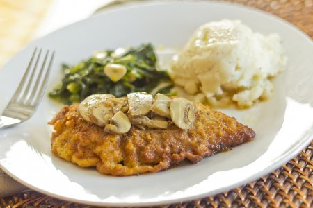 Photo for Crispy breaded chicken marsala with mashed potatoes and broccoli rabe with garlic - Royalty Free Image